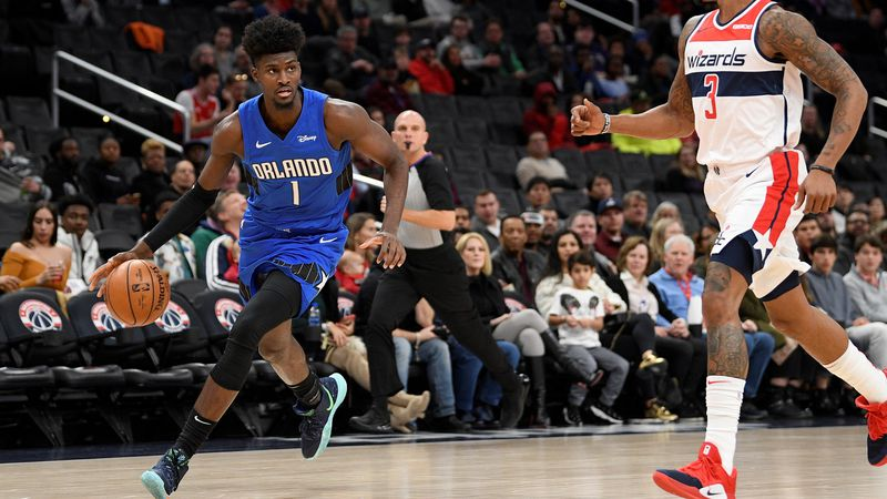Orlando Magic forward Jonathan Isaac (1) dribbles the ball against Washington Wizards guard...