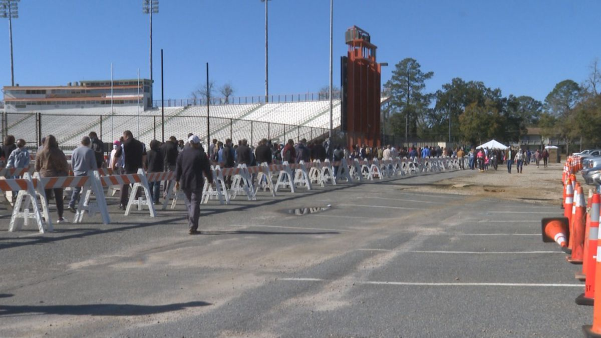 FILE PHOTO: People line up outside Bragg Memorial Stadium to get tested for coronavirus.