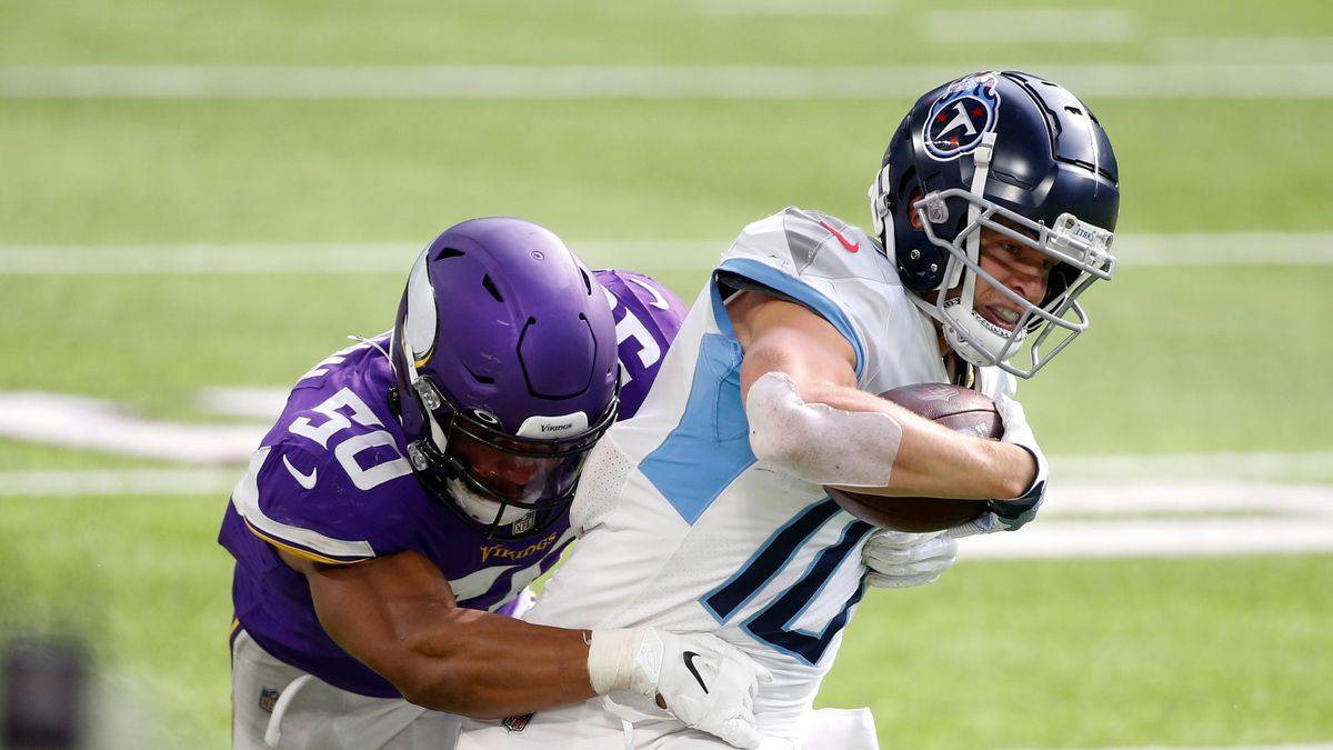 Tennessee Titans wide receiver Adam Humphries is tackled by Minnesota Vikings linebacker Eric...