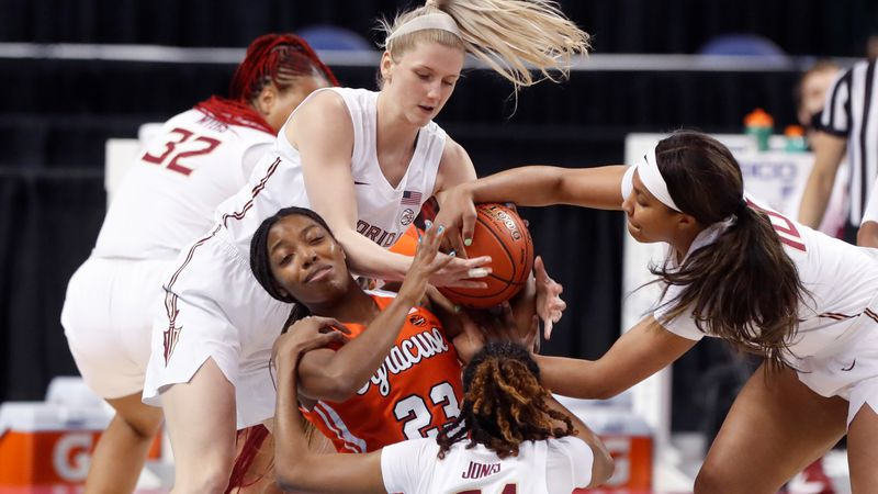 Florida State's Sammie Puisis (2), left, Morgan Jones (24), and Kourtney Weber (10) try to take...
