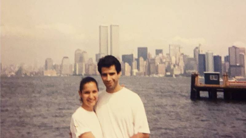 Sue and Jim Matheu stand in front of the Twin Towers, where Jim worked on September 11, 2001.