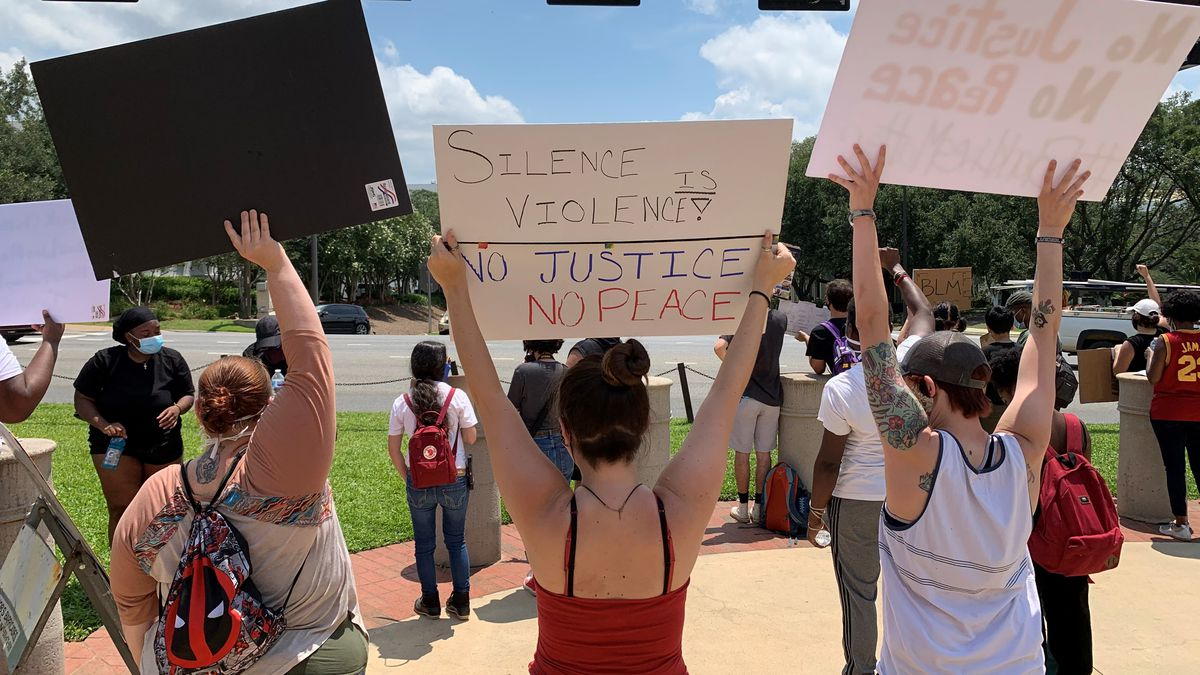 Dozens of people gathered in front of the State Capitol Building Monday to continue the protest of George Floyd's death from over the weekend.