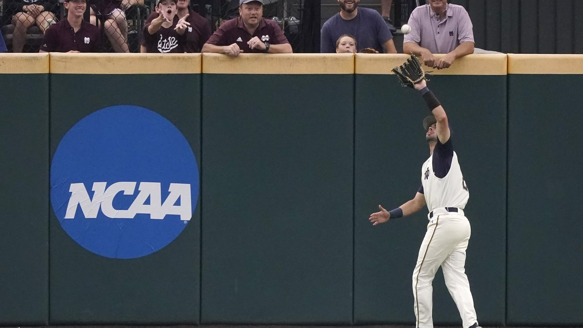 Mississippi State fans react as Notre Dame infielder Spencer Myers (2) catches a Mississippi...