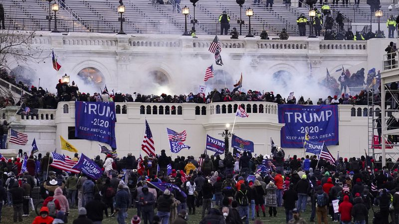 FILE - In this Jan. 6, 2021, file photo violent rioters, loyal to President Donald Trump, storm...