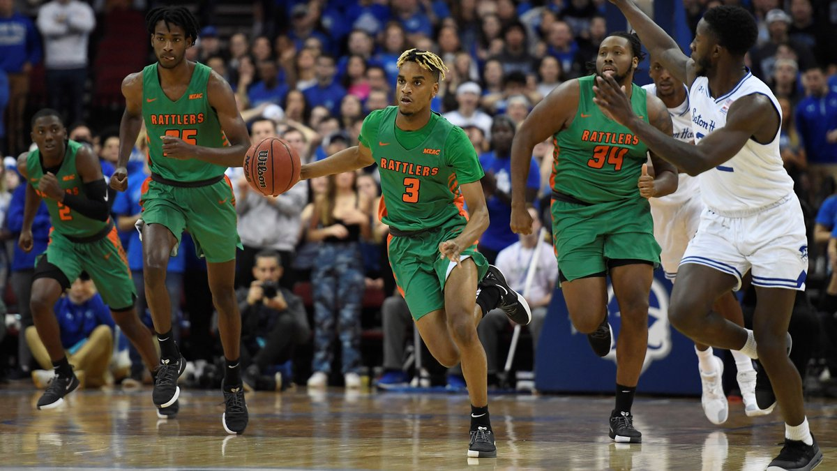 Florida A&M guard MJ Randolph (3) dribbles the ball during the first half of an NCAA college...