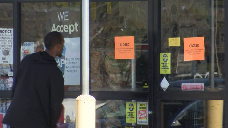 A customer sees a closed sign at a Georgia Dollar General.