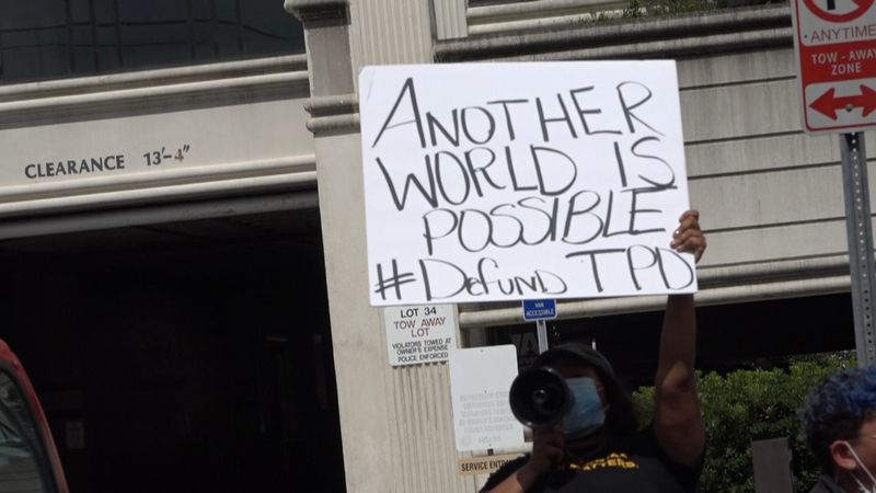 A protester outside of Tallahassee's city hall.