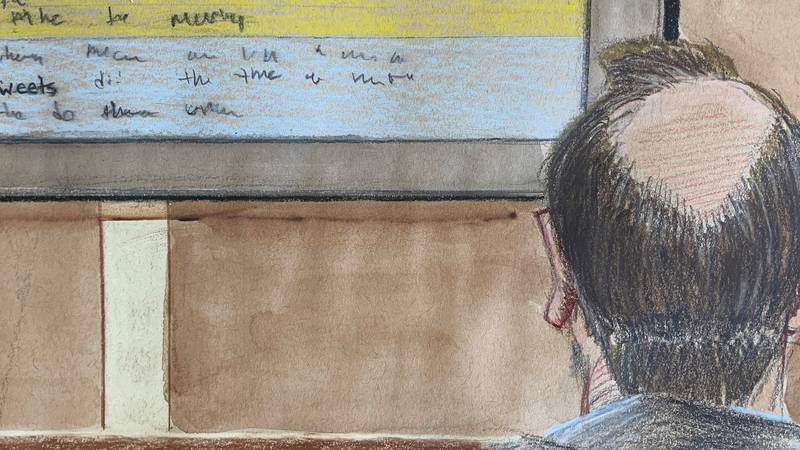 A courtroom sketch of JT Burnette looking at an exhibit the defense team presented.