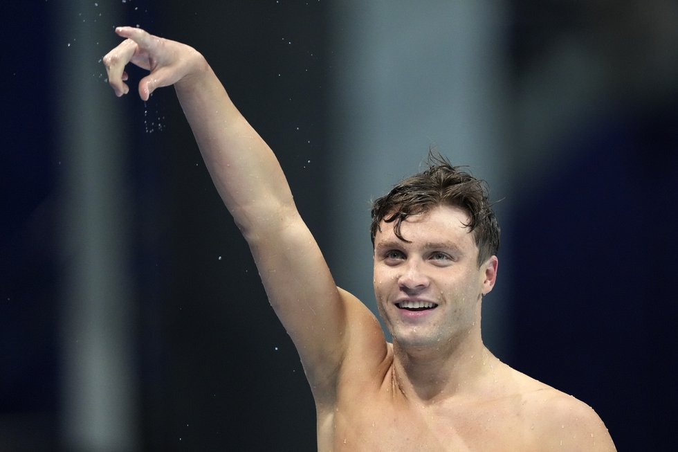 Robert Finke of the United States celebrates winning the men's 800-meters freestyle final at...