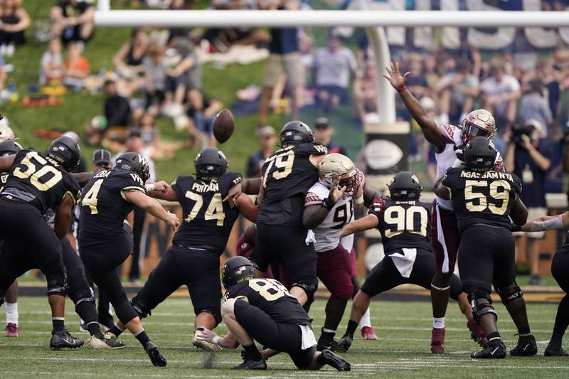 Wake Forest placekicker Nick Sciba (4) boots a field goal against Florida State during the...