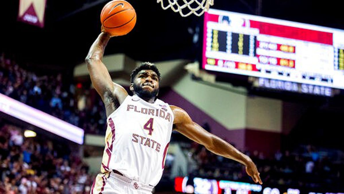 Florida State forward Patrick Williams (4) slams a dunk against Louisville in the second half...