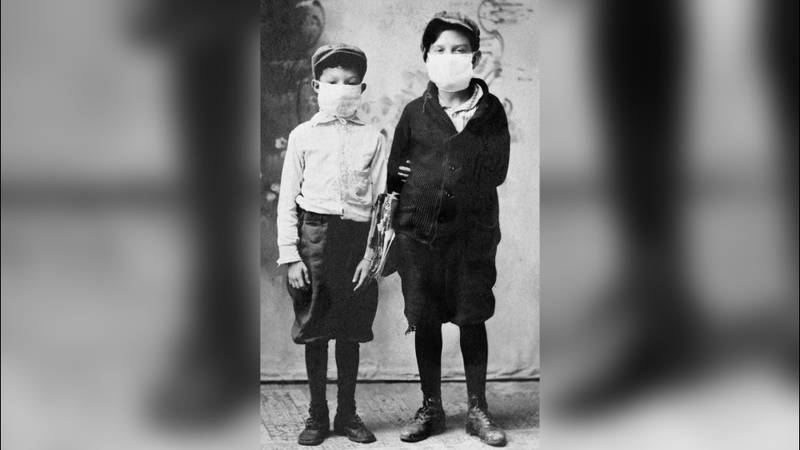 School-aged boys in Starke, Fla. pose for a picture while wearing masks in 1918.