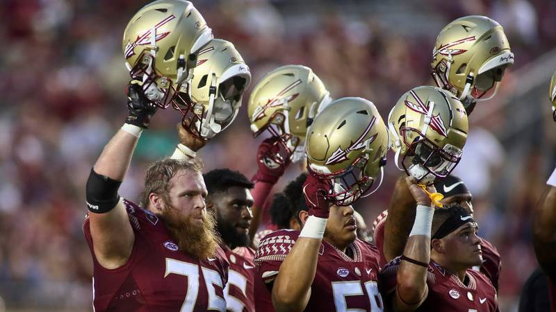 Florida State offensive linemen Dillan Gibbons (75) and Devontay Love-Taylor (58) and defensive...