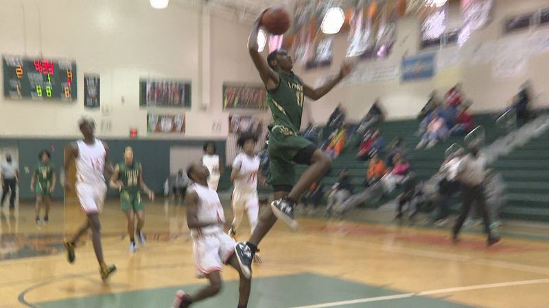 The Lincoln Trojans boys basketball team defeated the FAMU DRS Baby Rattlers, 54-39, at FAMU...