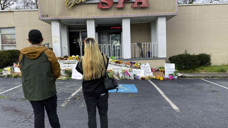 People view a makeshift memorial on Friday, March 19, 2021, in Atlanta.  Robert Aaron Long, a...