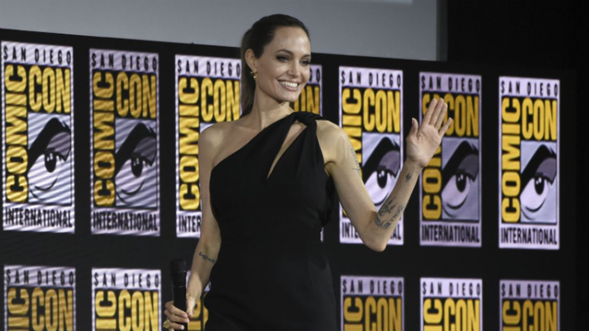 Angelina Jolie waves to fans as she walks on stage at the Marvel Studios panel on day three of Comic-Con International on Saturday, July 20, 2019, in San Diego. (Photo by Chris Pizzello/Invision/AP) (Source: Chris Pizzello)