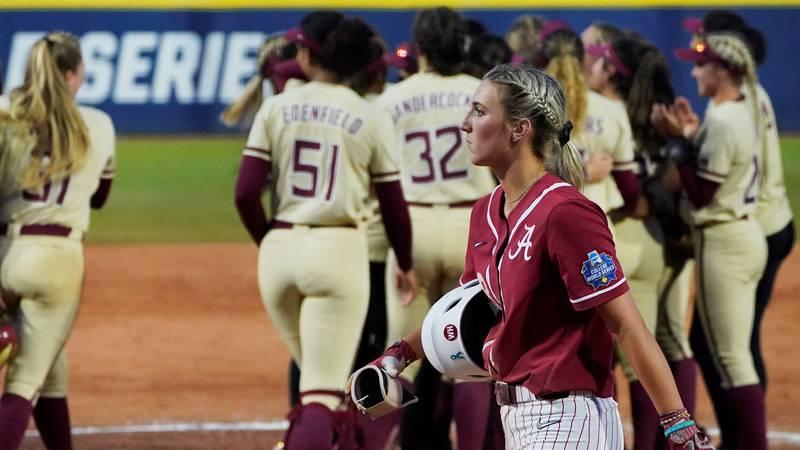 Alabama's Jenna Johnson, foreground, walks off the field as Florida State players celebrate...