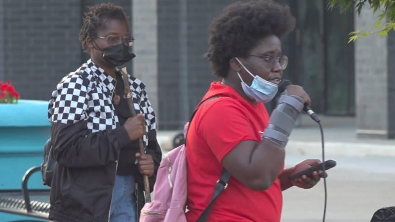 Activist Regina Joseph celebrates the Chauvin verdict at Cascades Park Tuesday evening.