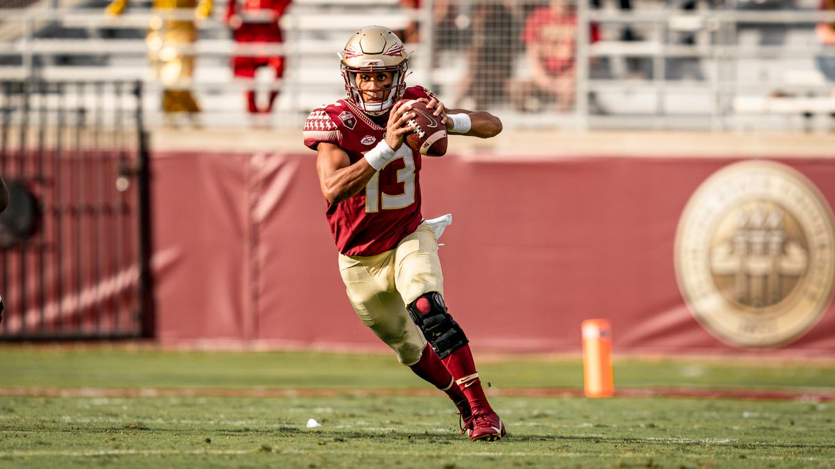 Florida State Quarterback Jordan Travis on the move against Jacksonville State.