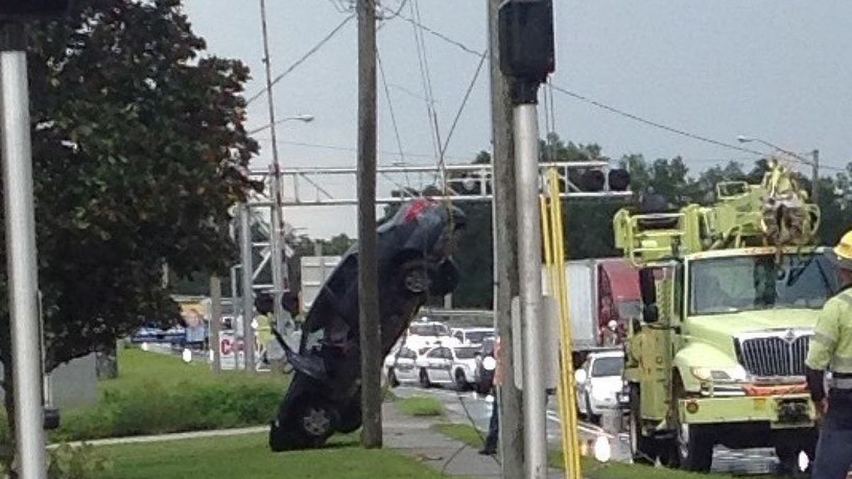Car crash in Ocala, Fla.  leaves car suspended on a power line