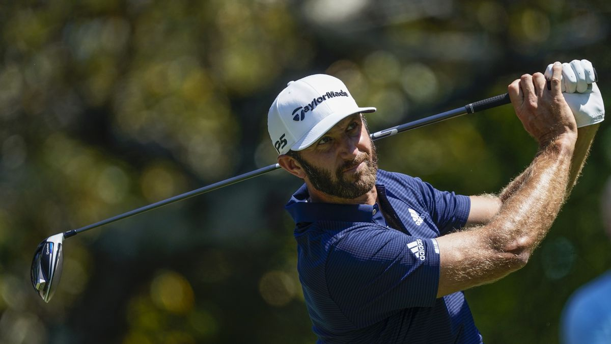 Dustin Johnson hits his tee shot on the fifth hole during the final round of the Tour Championship golf tournament at East Lake Golf Club in Atlanta, Monday, Sept. 7, 2020.