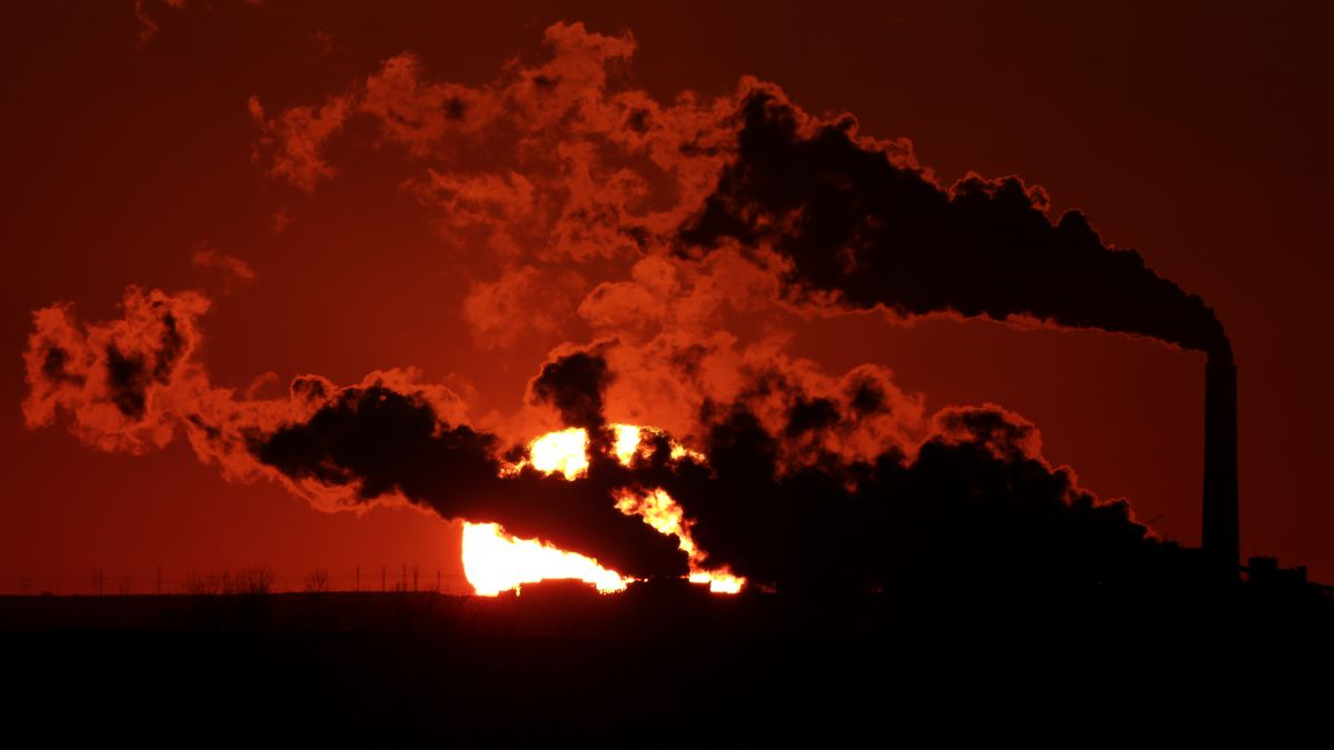 FILE- In this March 8, 2014, file photo steam from the Jeffrey Energy Center coal-fired power plant is silhouetted against the setting sun near St. Marys, Kan. (AP Photo/Charlie Riedel, File)