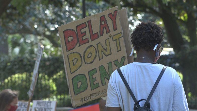 Teachers and parents take to the Governor's mansion to protest going back to school