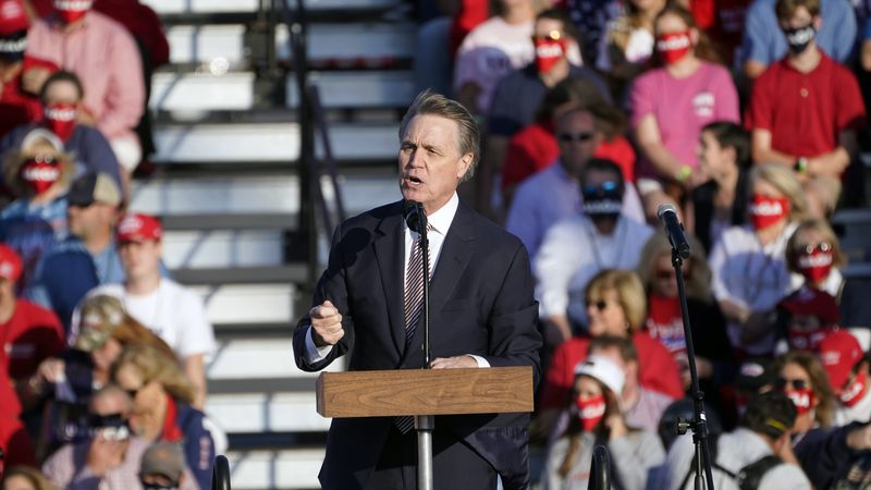 Sen. David Perdue, R-Ga., speaks during a campaign rally for President Donald Trump at Middle...
