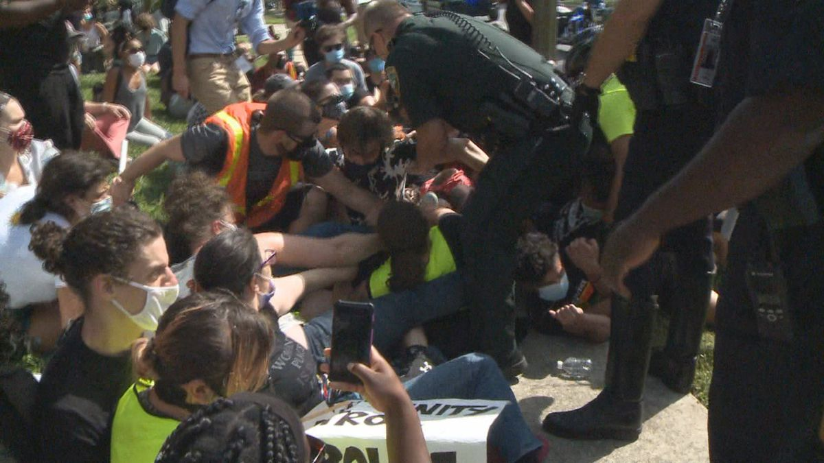 FILE PHOTO: Law enforcement officers arrest protesters marching to the Capitol Saturday. The...