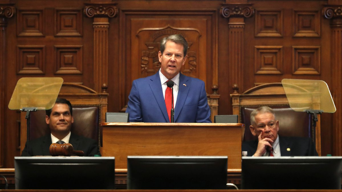 Gov. Brian Kemp, center, is flanked by House Speaker David Ralston, R-Blue Ridge, right, and...