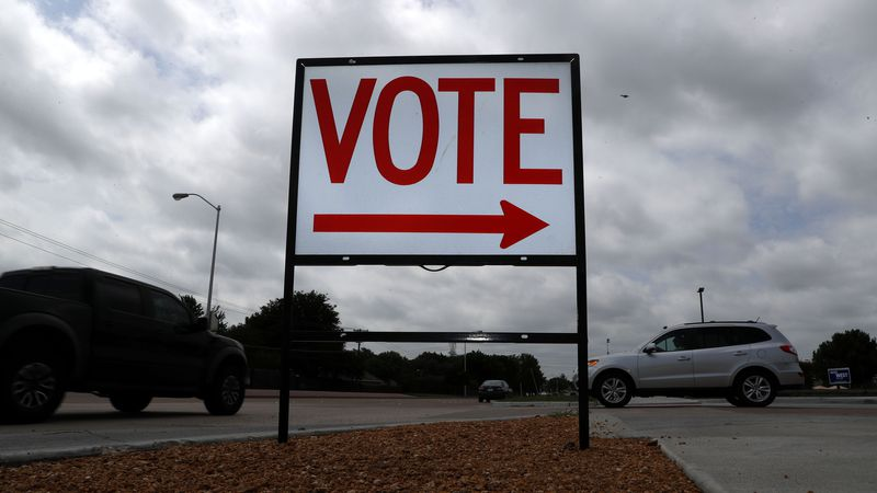 A sign points where to vote at a polling station in Plano, Texas.