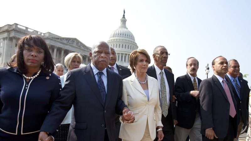 From left, Rep. Terri Sewell, D-Ala.,  Rep. John Lewis, D-Ga., House Minority Leader Nancy...