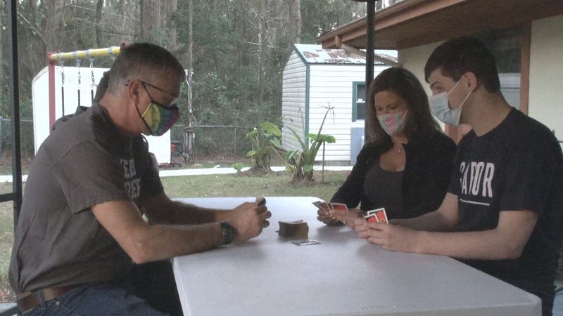 The Leatzow family plays Uno together after the facility their son lives in has allowed for...