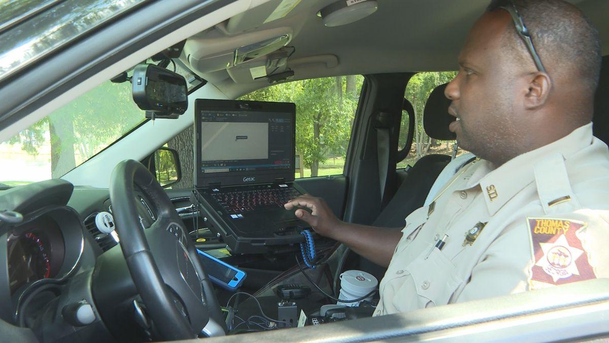 Lieutenant Ron Dillard demonstrates new 'mobile data terminal' for the Thomas County Sheriff's Office
