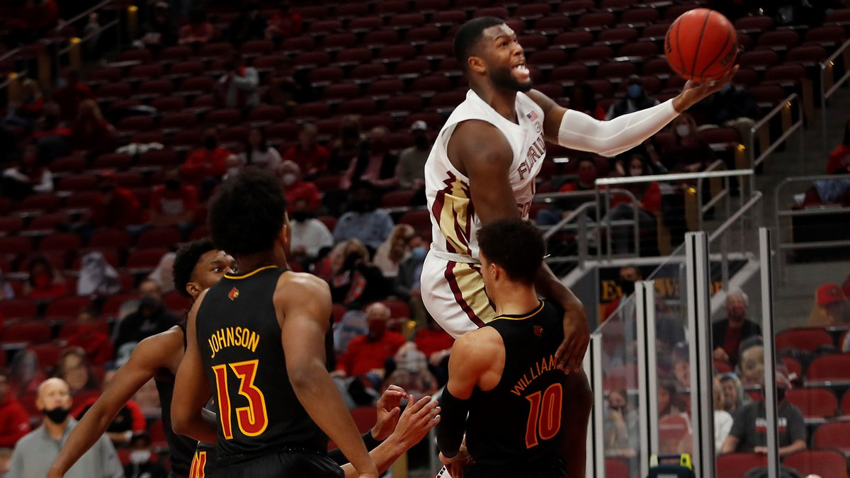 Florida State's RaiQuan Gray makes a shot over Louisville's Samuell Williamson.01/18/21