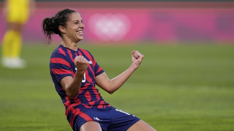 United States' Carli Lloyd celebrates scoring her side's 4th goal against Australia in the...