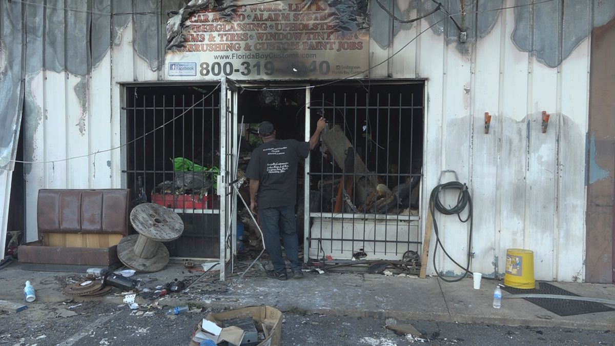 Florida Boys Customs owner Kent Randolph looks at what's left of his business.