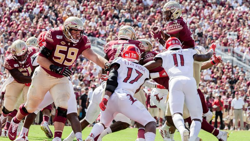 Florida State Seminoles running back Cam Akers (3) attempts to go over the top at the goal in...
