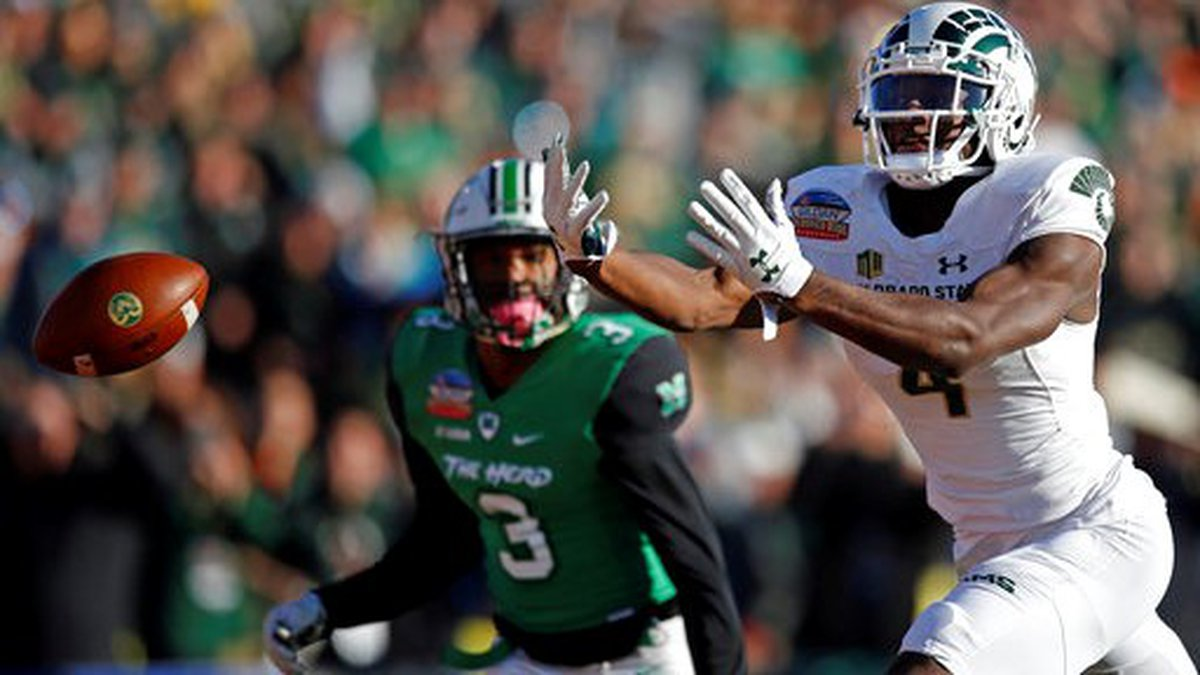 Colorado State wide receiver Michael Gallup (4) misses a reception as Marshall defensive back...