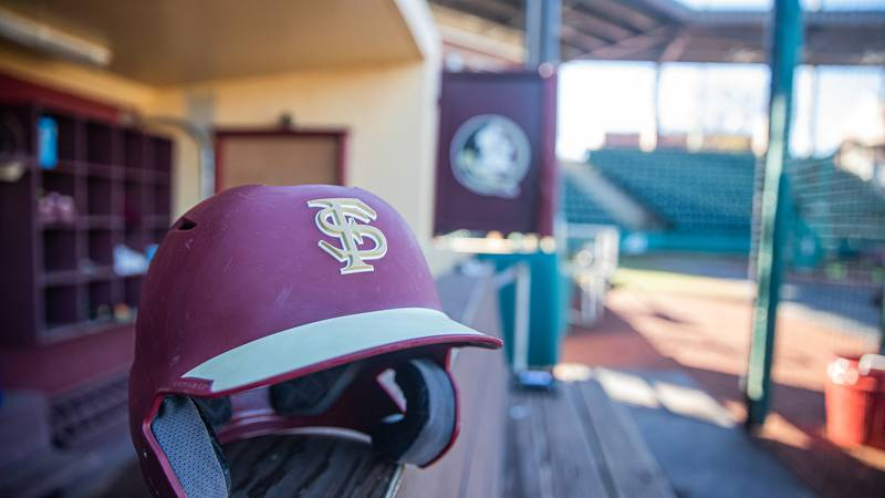 A Florida State Seminoles batting helmet rests in the dugout of JoAnne Graf Field