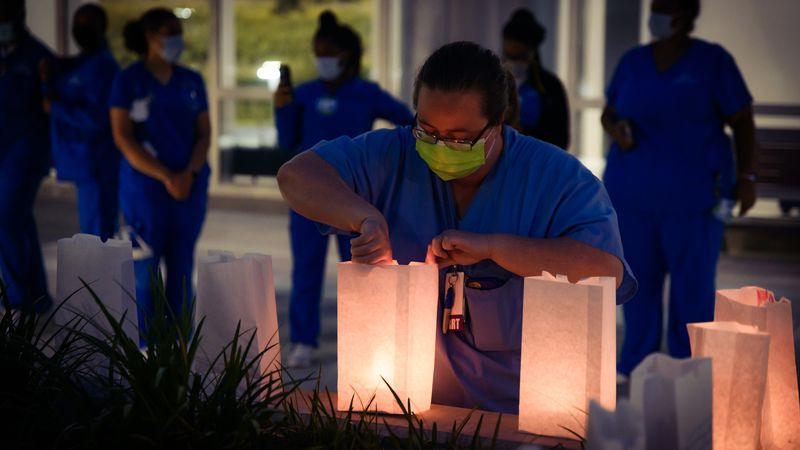 Tallahassee Memorial HealthCare held a luminary ceremony to honor the 217 lives it lost from...