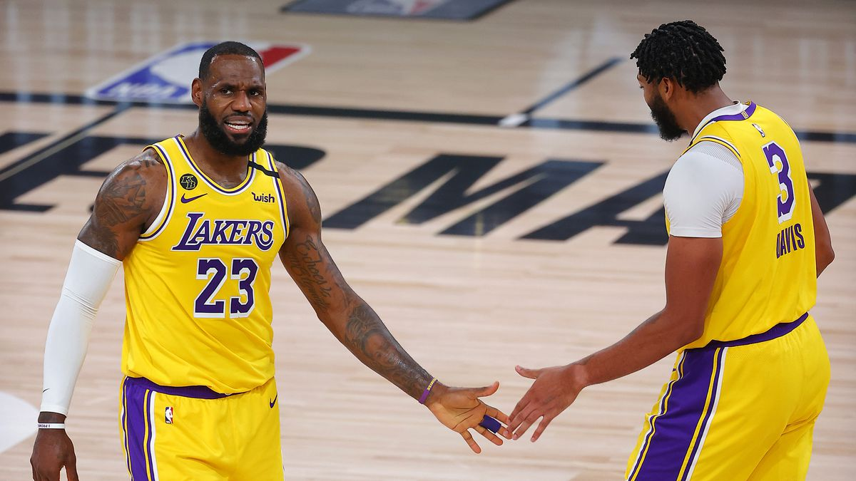 Los Angeles Lakers' LeBron James, left, and Anthony Davis react after a shot during the third quarter against the Portland Trail Blazers in Game 1 of an NBA basketball first-round playoff series, Tuesday, Aug. 18, 2020, in Lake Buena Vista, Fla.
