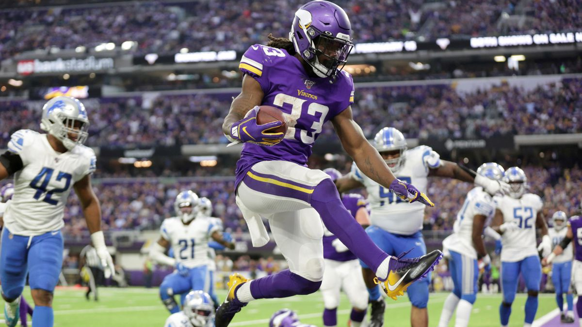 Minnesota Vikings running back Dalvin Cook (33) scores on a 3-yard touchdown run during the...