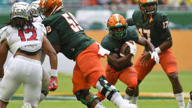 Florida A&M running back Bishop Bonnett (1) finds running room against Jackson State in the...