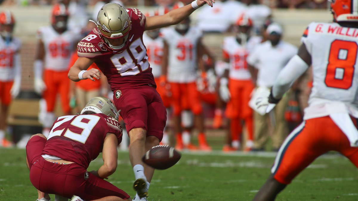 Florida State kicker Ryan Fitzgerald (88) misses an extra point as Alex Mastromanno (29) holds...
