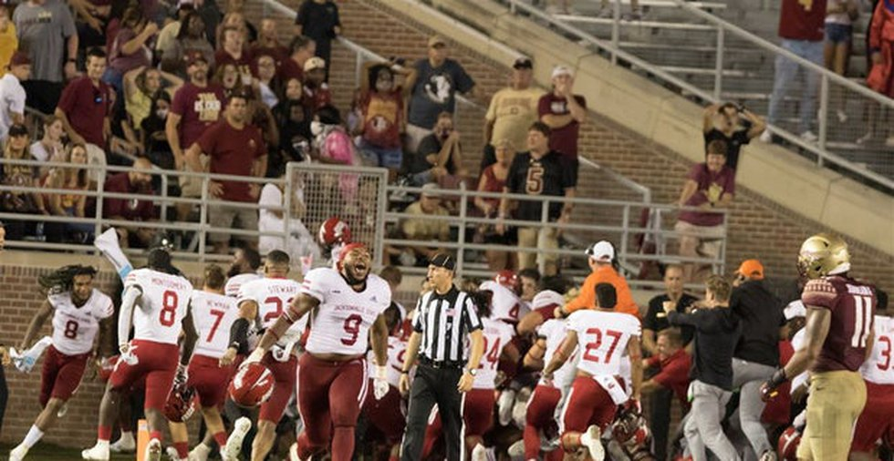 Jacksonville State celebrates after scoring on the final play to beat FSU