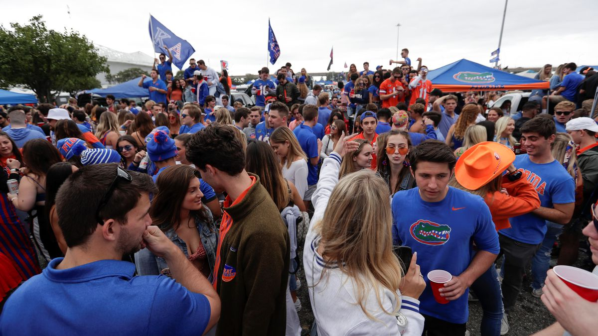 Fans party outside the stadium before an NCAA college football game between Florida and...