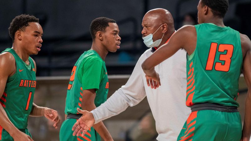 Florida A&M Rattlers head coach Robert McCullum speaks with his team during a time-out against...