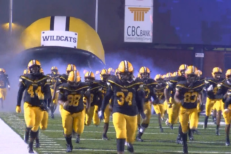 Valdosta football players run out of the tunnel
