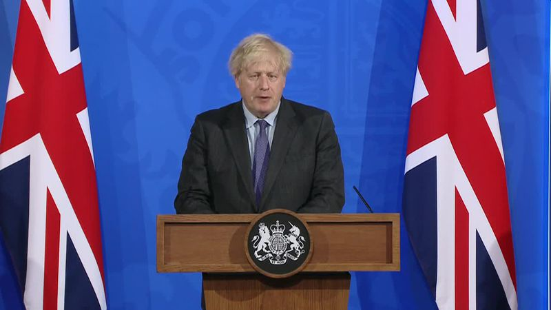 British PM Boris Johnson announces the delay of government plans to ease COVID-19 restrictions...